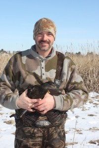 350 pix John Simpson Holding Black Duck